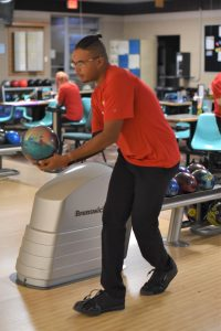 Johnny Brazier lines up his bowling ball.